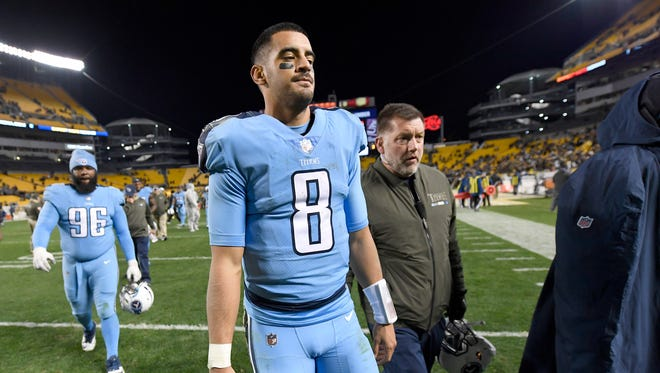 Titans quarterback Marcus Mariota walks off the field after the team's 40-17 loss to the Steelers on Thursday at Heinz Field.