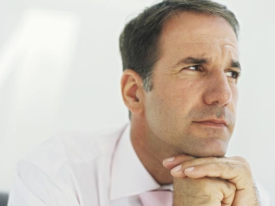 mature-man-thinking-with-chin-resting-on-hands_large.jpg