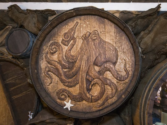 A hand-carved barrel inside Under Tow, a small tiki