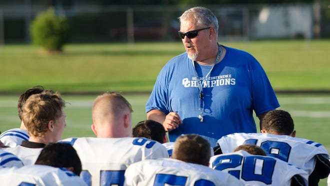 Oak Creek football coach Mike Bartholomew addresses his players at practice last month.