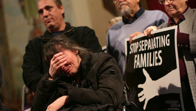 Flora Rranxburgaj breaks down as she talks about how she needs the help of her husband and cannot do without him if he gets deported during a press conference after he took sanctuary at Central United Methodist Church while facing deportation in Detroit on Tuesday, January 16, 2018. Ded Rranxburgaj and his wife Flora Rranxburgaj, both from Albania, immigrated to the U.S. 17 years ago and applied for refugee status within 5 months of their arrival. Eleven years ago Flora fell ill  with Multiple Sclerosis and her husband Ded has had to take care of her since. He recently received notice that he needed to live the country.