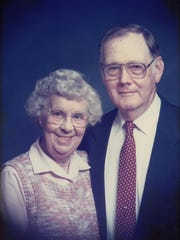 Dick Hughes keeps this undated photo of his late parents, Ruth and Jim Hughes, on his desk at work. The picture probably was taken for a church directory.