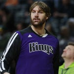 Sacramento Kings center Aaron Gray warms up before facing the Denver Nuggets on Feb. 23, 2014.