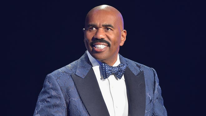 Steve Harvey performs at the 2015 Ford Neighborhood Awards Hosted By Steve Harvey at Phillips Arena on August 8, 2015, in Atlanta, Georgia.