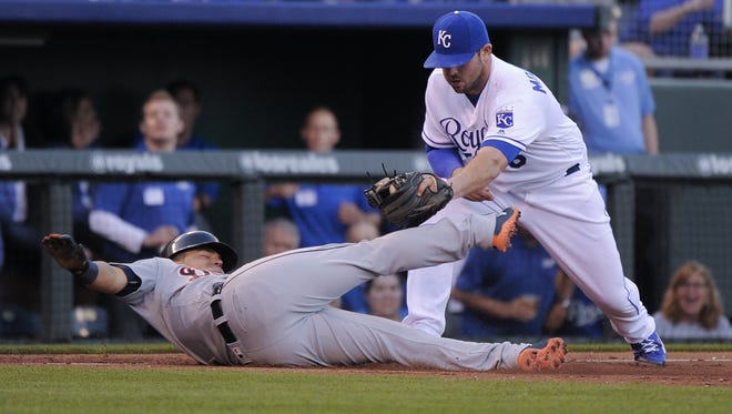 KANSAS CITY, MO - APRIL 21:  Jose Iglesias #1 of the Detroit Tigers is tagged out by Mike Moustakas #8 of the Kansas City Royals as he tries to advance to third from first on a Ian Kinsler single in the third inning at Kauffman Stadium on April 21, 2016 in Kansas City, Missouri. (Photo by Ed Zurga/Getty Images)