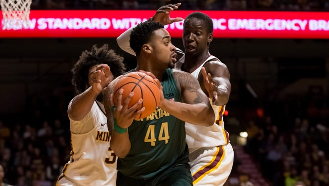 Minnesota Gophers center Bakary Konate (21) defends Michigan State Spartans forward Nick Ward (44) in the first half at Williams Arena.