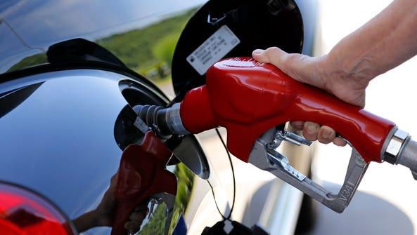 A customer re-fuels her car.