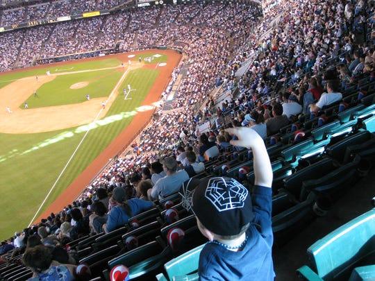 Bank One Ballpark high above left field.