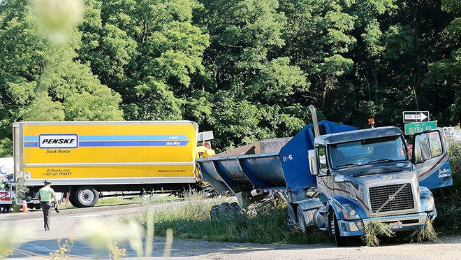 U.S. Route 30 was closed for most of the day Wednesday when hazardous materials spilled after a collision between a commercial tractor-trailer and a Penske rental box truck around 8 a.m.