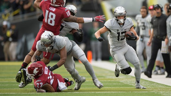 Oct 10, 2015; Eugene, OR, USA; University of Oregon Ducks wide receiver Devon Allen (13) picks up a first down during the first quarter in a game against the Washington State University Cougars at Autzen Stadium. Mandatory Credit: Troy Wayrynen-USA TODAY Sports