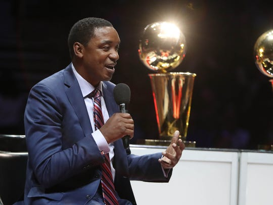 Former Pistons guard Isiah Thomas talks to fans during a halftime tribute of the Pistons' 121-102 win over the Lakers on Feb. 8, 2017 at the Palace.