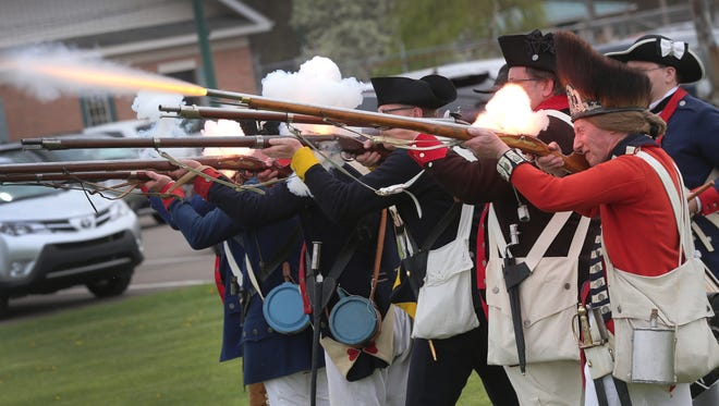 Bill Lucas fires off his musket as a Revolutionary War British red coat during the 2018 Ohio Civil War Show at the county fairgrounds.