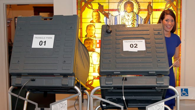 Secretary of State Alison Lundergan Grimes using a voting machine in Lexington in 2014.