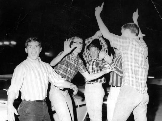 In this photo published March 21, 1966, students celebrated at Texas Western College. A planned dance the night after the Miners' national victory was broken up by police after an unauthorized bonfire, firecrackers and bottle-throwing.
