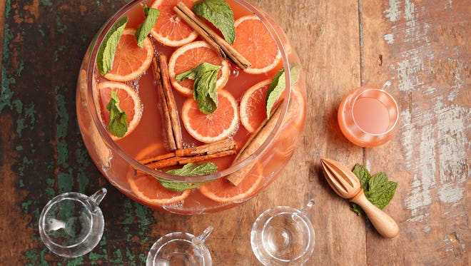 A holiday punch bowl filled with delicious nectar sets the stage for any great holiday gathering.