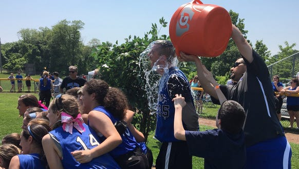 Pearl River softball coach Chris Woolgar is doused