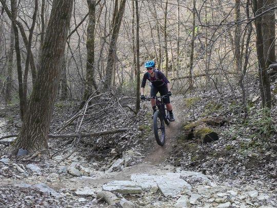 Josie Smith, a mountain bike rider from Decorah, glides