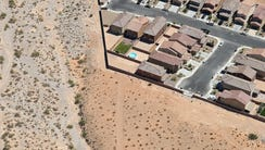 A small Las Vegas neighborhood is surrounded by open