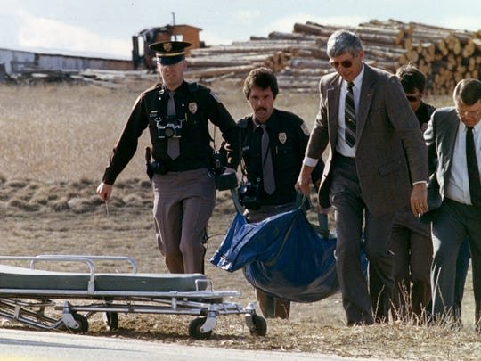 Police investigators move the body of Peggy Lee Hettrick from a field on Feb. 11, 1987. Tim Masters, who was 15 at the time of the killing, was convicted of murder in 1999, based on circumstantial evidence.  Photo courtesy of the Fort Collins Coloradoan