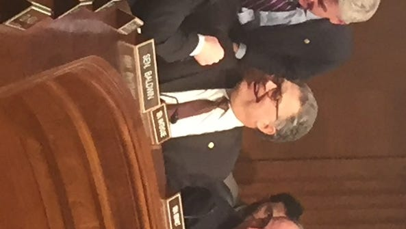 Sen. Bill Cassidy, R-La., (center) chats Tuesday with