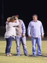 Rhett Cardwell, a four year member of the Union County High School Golf team, hugs his mother Nicole Welden.