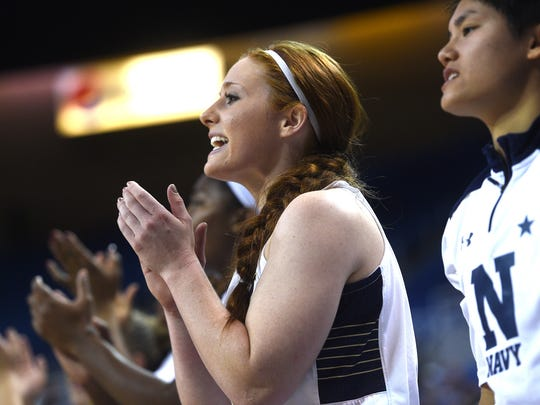 Navy's Sarita Condie, middle, cheers on her teammates while taking on Nevada at Lawlor Events Center on Friday