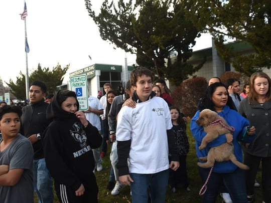 Over 100 people, including Devin Clark, middle, marched from Pat Baker Park to the Washoe County School District Administration Building to present a petition asking to allow school police to be able to carry pepper spray and tasers in Reno on Dec. 14, 2016.  The march and petition were in response to the shooting of 14-year-old Logan Clark by a WCSD police officer at Hug High School last week.