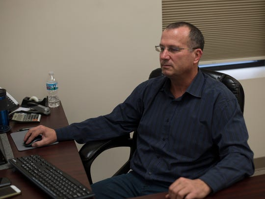 Omen USA plant manager Dror De-Porto sits in his office