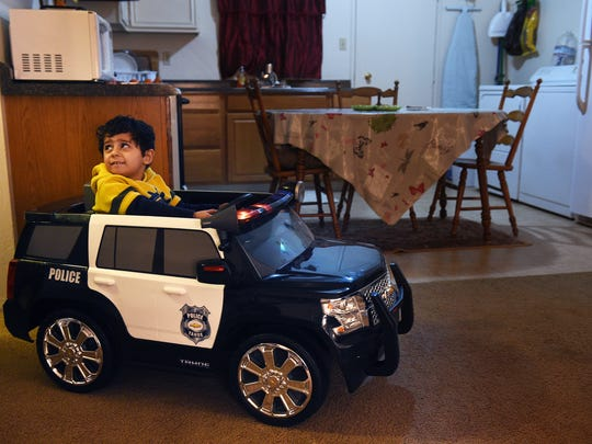 4-year-old Rahjad, son of Syrian refugees Zakaria Mustafa and his wife Nibhar Sheikmous, plays with his car in their apartment in Reno on Feb. 1, 2017. The car was purchased by Mustafa after earning his first paycheck while working in the United States of America.