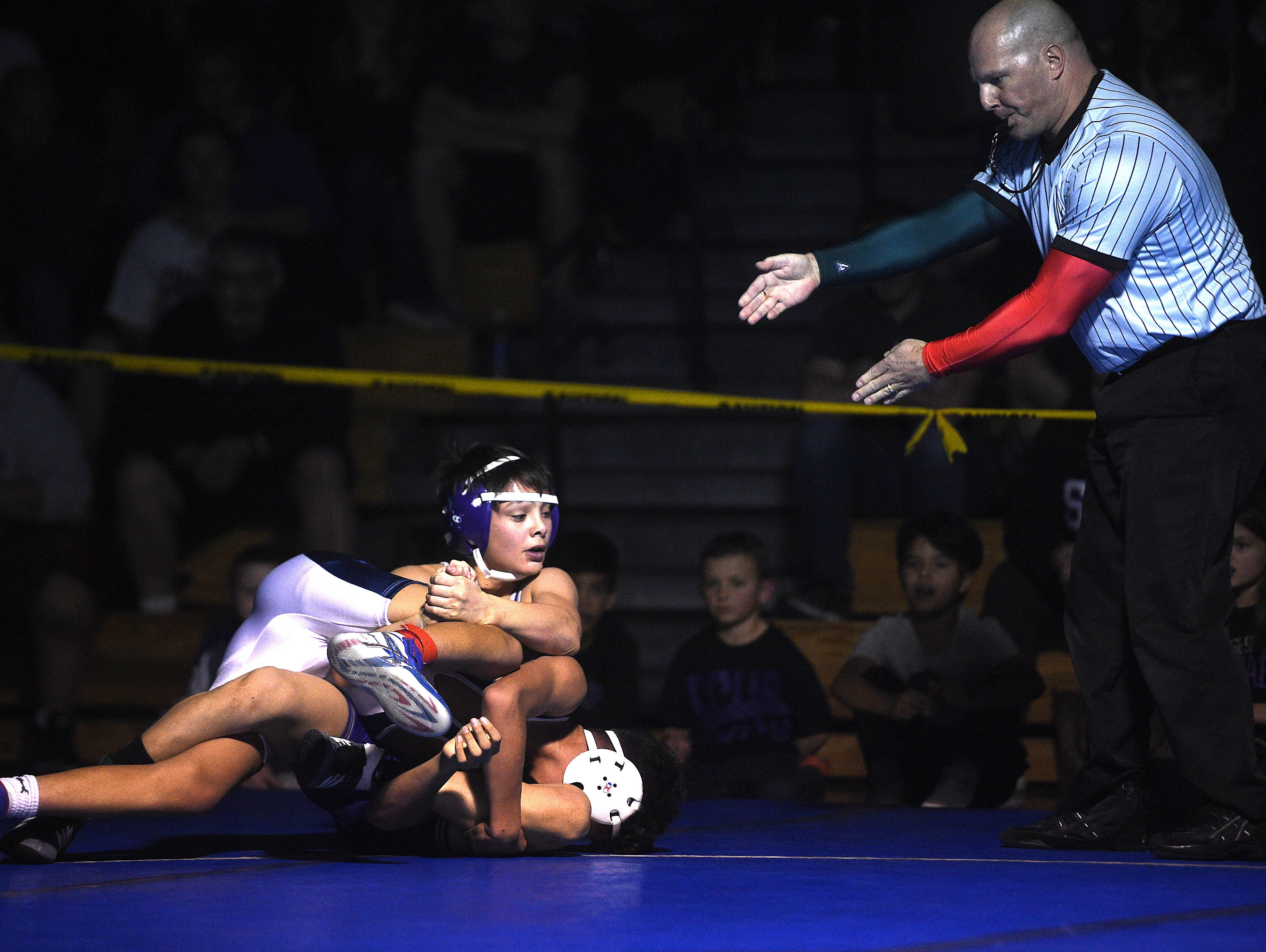 Spanish Springs' Anthony Sisson, top, defeats Reno's Eric Lopez to win the 106 pound division during the 4A Northern Region Wrestling championships at Reno High School on Saturday.