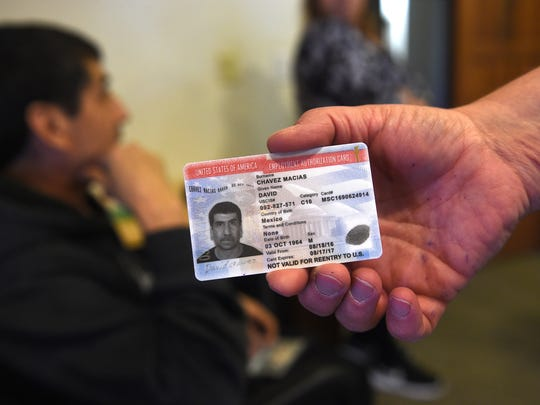 David Chavez-Macias' employment authorization card is seen at the Unitarian Universalist Fellowship of Northern Nevada in Reno on April 14, 2017. Chavez-Macias has been granted sanctuary by the church after being issued deportation orders by U.S. Immigration and Customs Enforcement, or ICE.