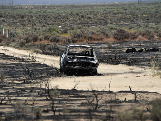 A burned vehicle is seen as a result of the Long Valley Fire east of Doyle, Calif. on July 13, 2017.