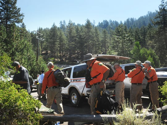 Search and Rescue teams focus their efforts while looking for missing teen Sean Ascuaga in the mountains along the shore of Lake Tahoe just south of Sand Harbor on July 18, 2017.