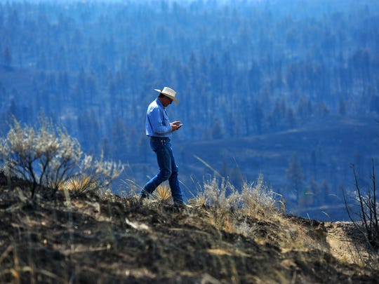 Tim Weyer of the Calf Creek Cattle Ranch tours his ranch, which was consumed by the Lodgepole Complex Fire, Tuesday afternoon.  While he was able to save his home, much of his grazing land was burned in the fire leaving him struggling to find suitable grazing land for his 350 head of cattle.