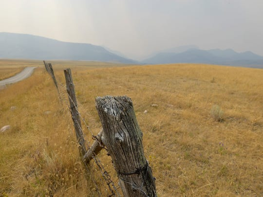 Thick smoke from the Alice Creek fire hangs over the Rocky Mountain Front on Tuesday afternoon, in between Augusta and Highway 200.