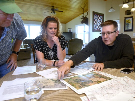 Louie and Stacy Hermiller, left, and George Nikolakakos are opposing a proposed slaughter plant that will be built near their homes east of Great Falls.