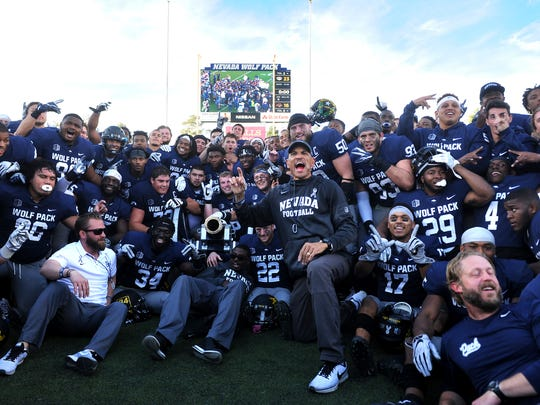 Nevada celebrates after defeating UNLV to win the battle for the Fremont Cannon at Mackay Stadium in Reno on Nov. 25, 2017.