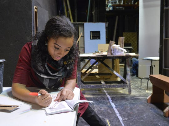 "Taniya Reovan, who plays Calpurnia, reviews her lines backstage during Tuesday's rehearsal of the Great Falls High theater program's production of ""To Kill A Mockingbird."" The school has decided to keep all of the original language, including the 'n-word,' in the play."