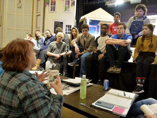 "Great Falls High performing arts teacher Krystina Thiel reviews the previous scene with her cast during Tuesday's rehearsal of ""To Kill a Mockingbird."""
