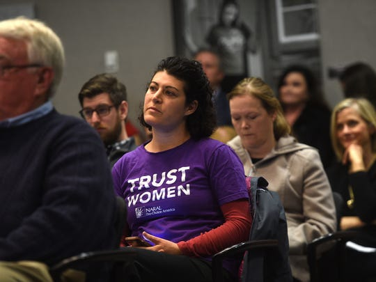 Molly Rose Lewis, middle in purple, and her fellow citizens listen as Reno City Attorney Karl Hall speaks during a Reno City Council meeting on Feb. 23, 2018.