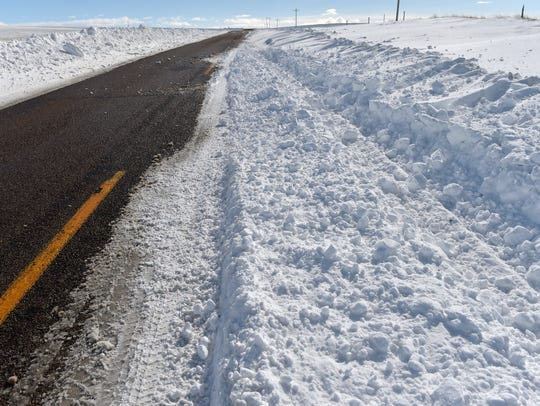 Snow drifts across the Santa Rita Highway north of Cut Bank.