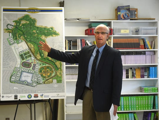 WCSD Chief Operating Officer Pete Etchart speaks to media about the district's original example of what a new high school on the Wildcreek Golf Course could look like on April 26, 2017.
