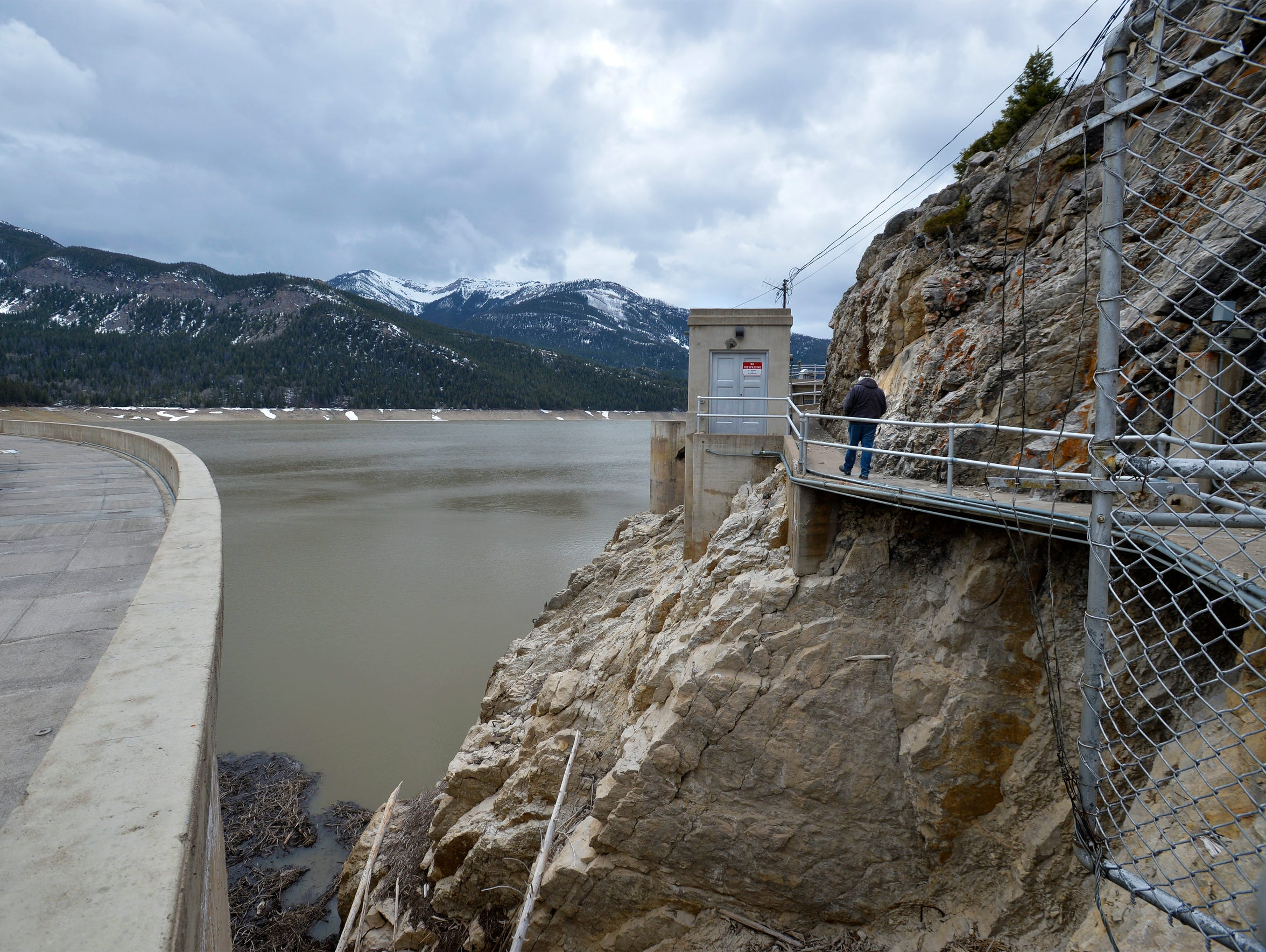 Paul Bergstrom, dam operator at Gibson Dam, walks to the generator house where controls are located for the spillway.