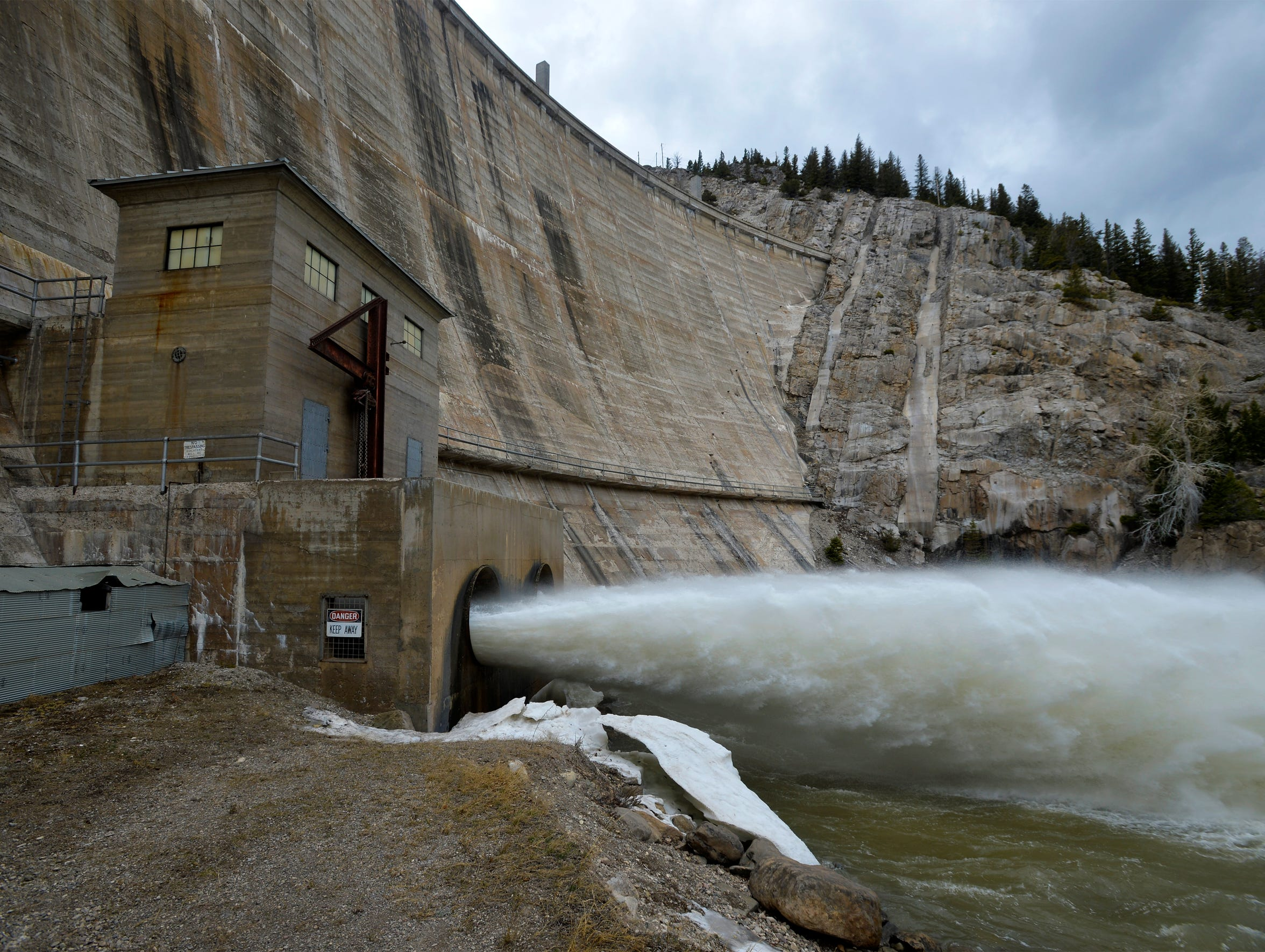 72-inch pipes shoot water from the outflow gates at