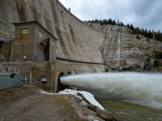 Water that shoots out of two 72-inch pipes at the base of Gibson Dam would be tapped for power.