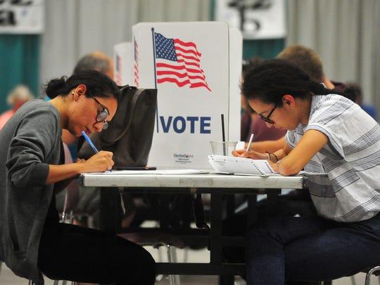 Alma Castillo, left, and her sister Viviana vote in