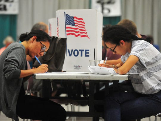 Alma Castillo, left, and her sister Viviana vote in Montana primary election on Tuesday in Exhibition Hall.