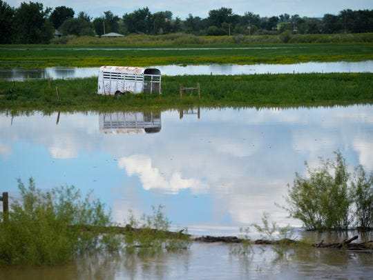 The Sun River floods pastures south of Vaughn, Mont.