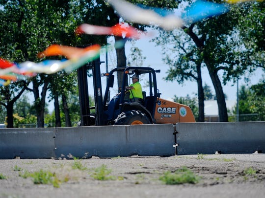 A county worker positions cement barriers across one of the roadways at Montana ExpoPark on Monday afternoon.  Montana ExpoPark will host a rally by President Donald Trump on July 5th in the Four Seasons Arena.