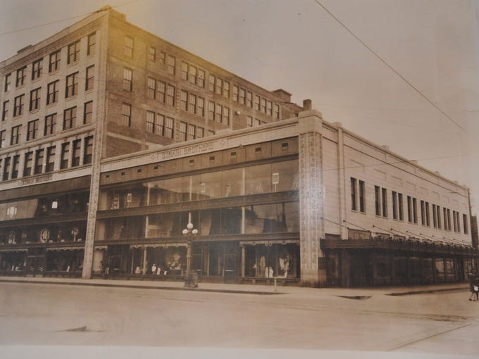 A historic photo of the original Strain Building at